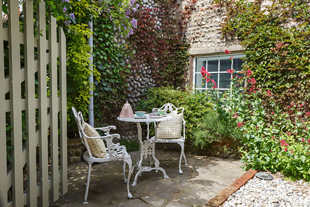 Tea for two in Snugglers Den courtyard garden